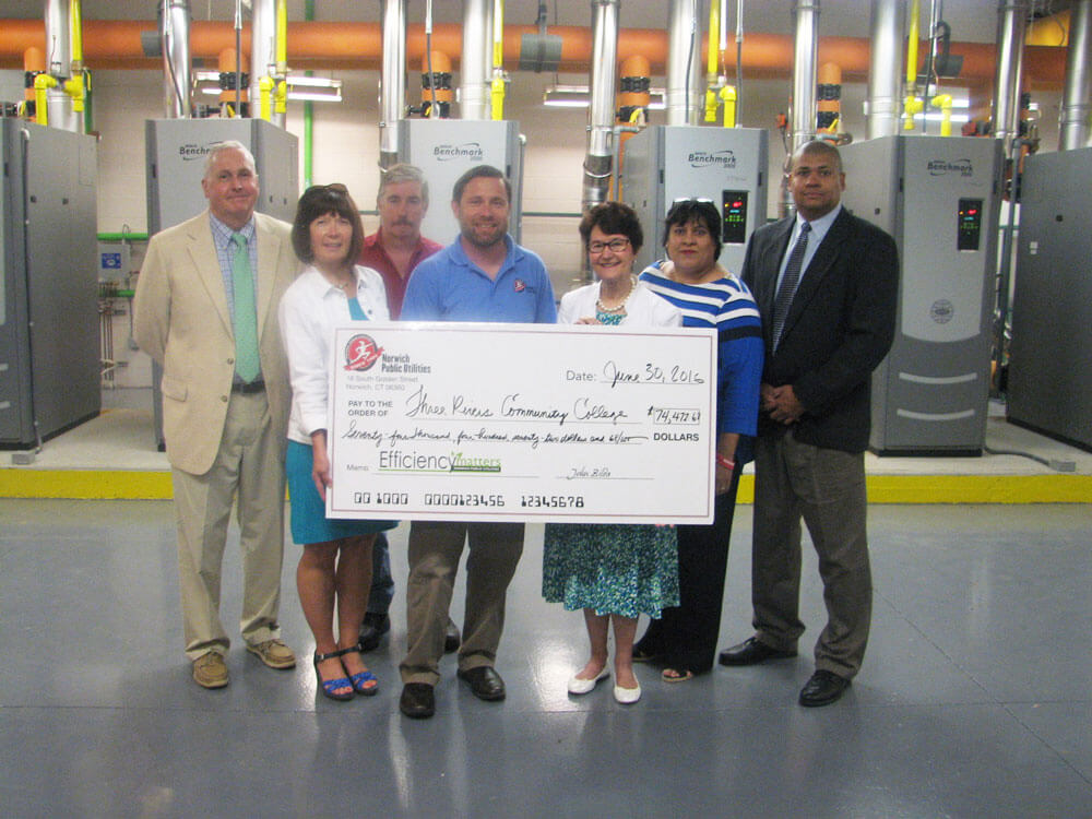 Group holding a check