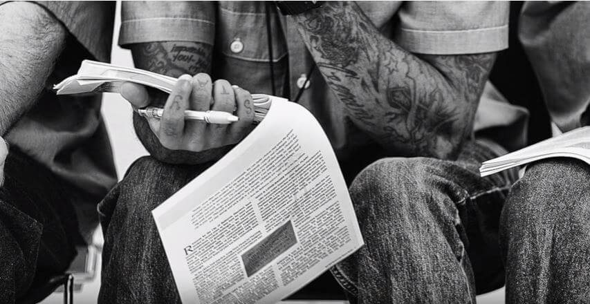 person reading a paper